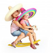 Two mexican riders on  a rocking horse.