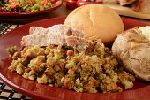 stock photo of butter-lettuce  - Sliced turkey on herbal stuffing with a baked potato and healthy salad - JPG