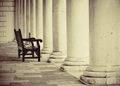 Urban historical architecture with chair in London.