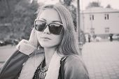 Women in sunglasses street closeup image. BW or sepia film style instagram colors
