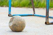 Broken Football On Concrete Field