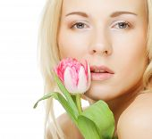 Blonde girl with tulip