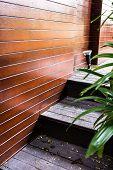 Wooden Staircase On Garden Home.