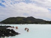 Visitors enjoying famous Blue Lagoon Geothermal Spa in Iceland