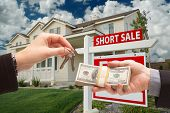 pic of eviction  - Handing Over Cash For House Keys and Short Sale Real Estate Sign in Front of Home - JPG