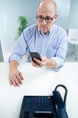 Man Surprised At His Mobile Phone
