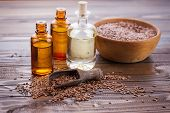 stock photo of flax seed oil  - Flax seeds oil on wooden background - JPG