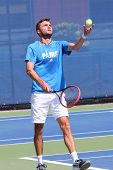 Professional tennis player Gilles Simon practices for US Open 2014