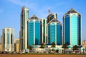 Sharjah, United Arab Emirates - April 21, 2014: Luxury Building On The Streets Of Sharjah Grow Befor