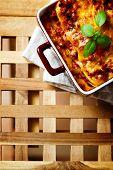 Italian Food. Lasagna Plate On Wooden Table.