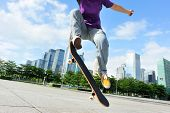 woman skateboarder skateboarding at city