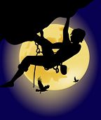 Climber On The Background Of The Full Moon