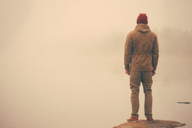 picture of boy scout  - Young Man standing alone outdoor with foggy scandinavian nature on background Travel Lifestyle and melancholy emotions concept film effects colors - JPG