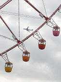 Ferris Wheel And The Plane