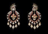picture of diamond  - Pair of diamond and pearl earrings with many diamonds isolated over black background - JPG