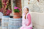 Cute little girl resting outoors on a nice autumn day