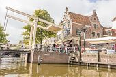 People walking on the famous drawbridge in Alkmaar