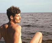 handsome young man at beach, hot vacations at lake