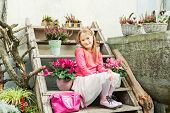 Fashion portrait of a cute little girl, outdoors