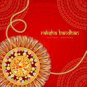 pic of rakhi  - Beautiful rakhi with gems on shiny red and beige background for the festival of Raksha Bandhan celebrations - JPG