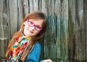 image of cute innocent  - Outdoor portrait of a cute little girl in glasses - JPG