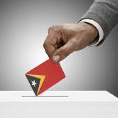 Black Male Holding Flag. Voting Concept - East Timor
