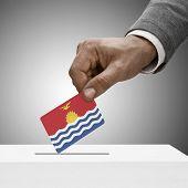 Black Male Holding Flag. Voting Concept - Kiribati