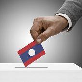 Black Male Holding Flag. Voting Concept - Laos