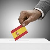 Black Male Holding Flag. Voting Concept - Spain