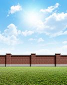 Brick Wall Grass And Blue Sky