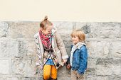 Fashion portrait of adorable kids outdoors