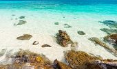 picture of crystal clear  - Rocks in beautiful turquoise crystal clear sea water - JPG