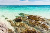 stock photo of crystal clear  - Rocks in beautiful turquoise crystal clear sea water - JPG