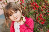 Spring portrait of adorable little girl of 4 years old