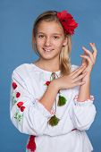 foto of preteen  - A cheerful preteen Ukrainian girl on the blue background - JPG