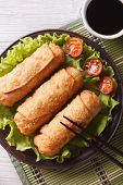 Spring Rolls Fried On Lettuce Close-up, Vertical Top View