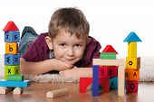 picture of little boys only  - A little boy plays with toys on the floor - JPG
