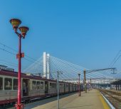 stock photo of passenger train  - Passenger train in train station over a nice white bridge - JPG