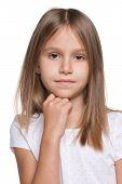 Pensive Little Girl Against The White Background