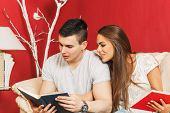 Young Couple Learning At Home