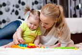picture of indoor games  - mother and kid boy play together indoors - JPG