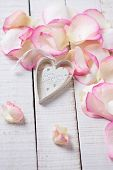 Heart On Petals On Wooden Background