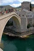 Water Jumping From A Famous Old Bridge In Mostar