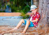 Cute Fashionable Boy Near The Tree On The Beach