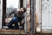 picture of possess  - Evil looking possessed man in destroyed building - JPG