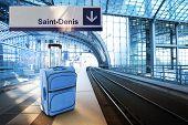 Departure For Saint-denis, France. Blue Suitcase At The Railway Station