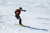 Ski mountaineering: ski mountaineer rides skiing from mountain