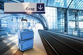 Departure For Graz, Austria. Blue Suitcase At The Railway Station