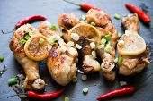 Grilled Chicken Legs With Hot Red Peppers and Fresh Herbs
