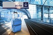 Departure For Berlin, Germany. Blue Suitcase At The Railway Station